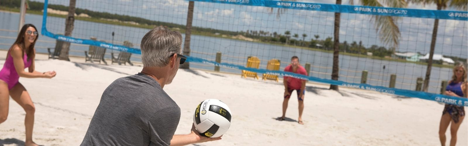 People playing volleyball outside at Naples Reserve