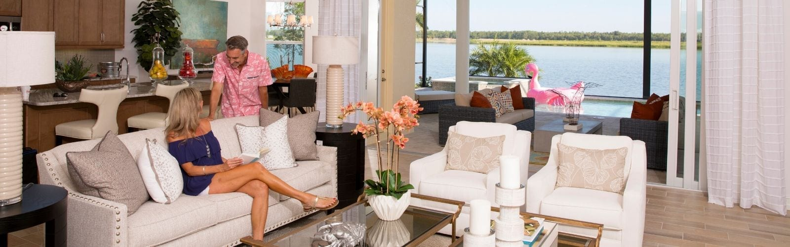 A couple enjoying the interior of their home at Naples Reserve